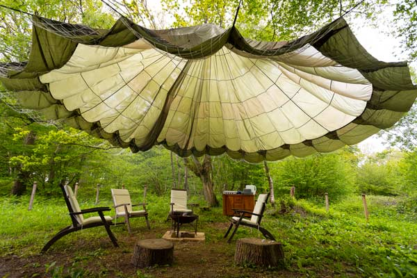 Outdoor seating, fully-equipped kitchen and fire pit for Stargazer tent and Touareg tent glamping near Eurotunnel, Canterbury and Dover in Kent